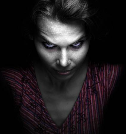 45393300-scary-spooky-evil-woman-in-the-dark copy